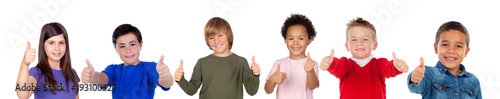 Happy children saying Ok with their thumbs