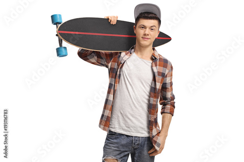 Teenage hipster holding a longboard