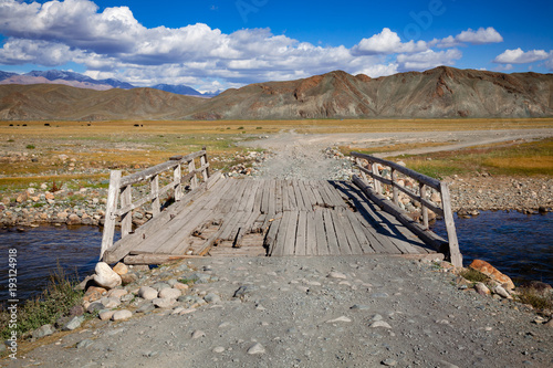 Worn down wooden bridge in Altai Mountains Mongolia