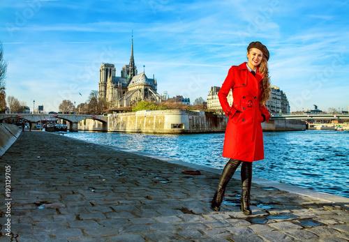 Fridge magnet traveller woman standing on embankment near Notre Dame de Paris