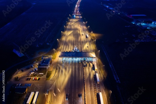 Deurstickers Nacht snelweg Aerial drone view on motorway with toll collection point