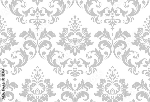 Wallpaper in the style of Baroque. A seamless vector background. White and grey floral ornament. Graphic vector pattern. - 193133909
