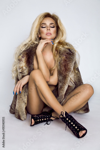 Beautiful, sexy naked blond model, dressed only in elegant  fur. Poster