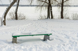 Winter landscape with empty bench in deep snow on a Dnipro riverside, Ukraine - 193142596