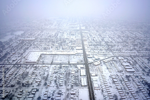 Foto op Plexiglas Chicago Aerial view of the Chicago suburbs covered with snow after a winter storm near O'Hare airport (ORD)