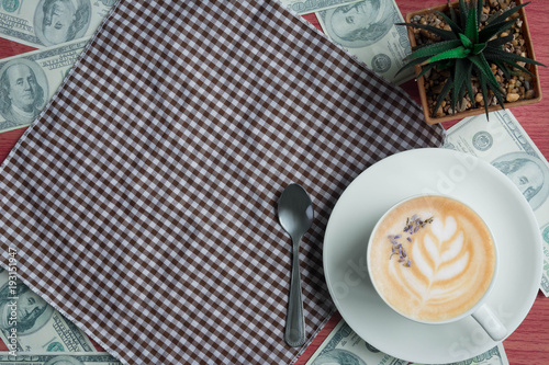 Sticker Business concept with coffee, money, cactus and fabric on pink wooden table