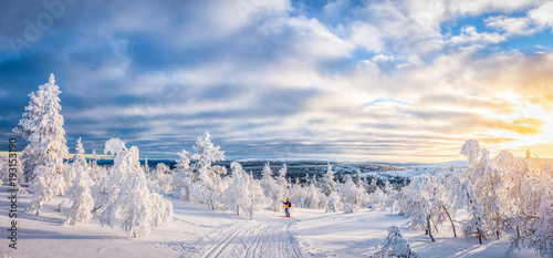 Cross-country skiing in Scandinavian winter wonderland at sunset © JFL Photography