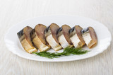 Slices of smoked mackerel with dill in dish on table - 193159151