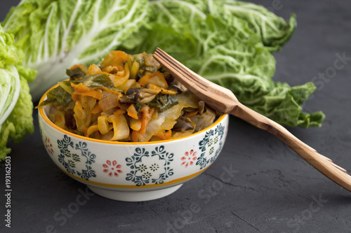 Stewed cabbage in bowl on grey background. - 193162503