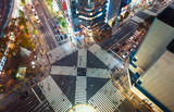 Aerial view of people crossing a big intersection in Ginza, Tokyo, Japan at night
