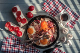 Delicious breakfast with fried eggs, sausage, sandwichs and coffee cup top view. Food photography - 193166761