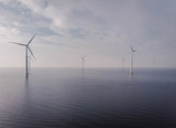 Offshore Windmill farm in the ocean  Westermeerwind park , windmills isolated at sea on a beautiful bright day Netherlands Flevoland Noordoostpolder birde eye view drone view - 193166948