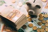 Piggy moneybox with euro cash and coins closeup. Financial concept - 193166957