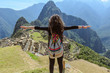 Woman looking at Machu Picchu, Peru