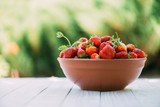 Natural organic strawberry from an own garden in ceramic bowl. Summer day at rural farm. Agriculture concept - 193168146