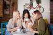 Group of female friends having a coffee together. Three women at cafe, talking, laughing and enjoying their time. Lifestyle and friendship concepts with real people models.