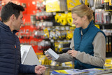 female hardware store seller scanning clients item - 193178157