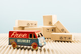 Free delivery van, vintage toy truck with cardboard boxes. Shipping concept. - 193178535