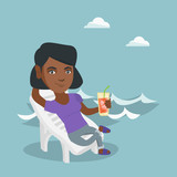 Young african-american woman sitting on a chaise-longue on the beach. Happy smiling woman relaxing on a chaise-longue and drinking a cocktail on the beach. Vector cartoon illustration. Square layout.