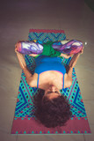 young woman lying on mat with legs in lotus position indoor shot from abov - 193183159