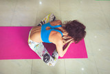 young woman practice yoga indoor shot bend forward in sit position from above - 193183329