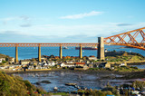 A view from the east footpath of the Forth Road Bridge, looking over North Queensferry towords the old and famous Rail Bridge. - 193186922