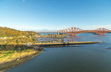 A view from the east footpath of the Forth Road Bridge, looking over North Queensferry towords the old and famous Rail Bridge. - 193186947