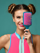 Young happy woman close eyes with pink and blue big hair comb brush smiling