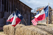 American and Texas flags arranged on straw bales, independence day decoration