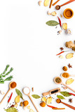 Seasoning background. Dry spices near ginger, garlic, rosemary, laurel leaf on white background top view copy space - 193215131
