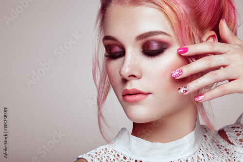 Leinwanddruck Bild Blonde Girl with Elegant and shiny Hairstyle. Beautiful Model Woman with Curly Hairstyle. Care and Beauty Hair products. Nails and Manicure