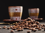Cup of coffee in mirror reflection, coffee beans, dark background. - 193249156