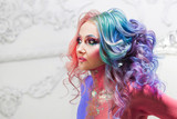 Beautiful woman with bright hair. Bright hair color, hairstyle with curls. - 193261773