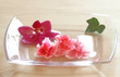 pink blossoms on a glass plate