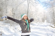 Happy young woman playing in the snow