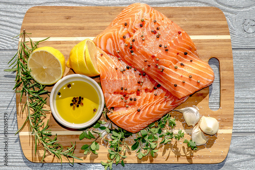 Close up ingredients for salmon filet with Italian herbs on bamboo tray - 193269579