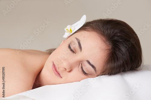 Fototapeta Female Enjoying Relaxing In Cosmetology Spa Center