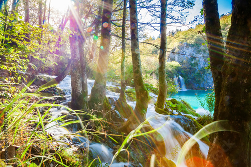 waterfall with sunlight rays in Plitvice - 193300173
