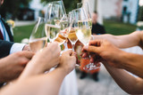 People hold in hands glasses with champagne, friends celebrating and toasting - 193307768