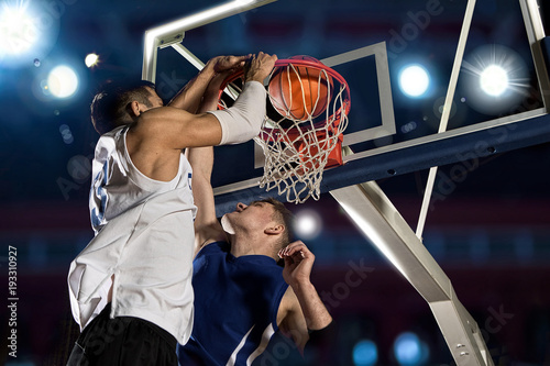 Fotobehang Basketbal Two basketball players in action