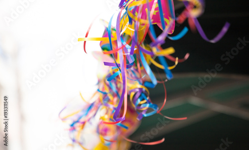 Carnival colorful serpentines on blurred background. Close up view with details, copy space, banner