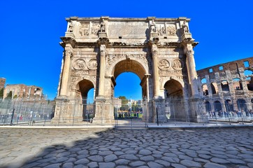 Rome, Italy, the ancient Arch of Constantine under blue skies.