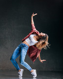 Young beautiful female dancer is posing in the studio - 193349151