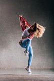 Young beautiful female dancer is posing in the studio - 193349184