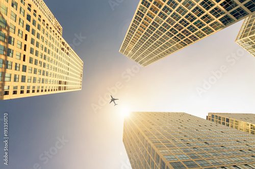 Foto op Canvas Peking Low angle shot of modern glass city buildings with clear sky background