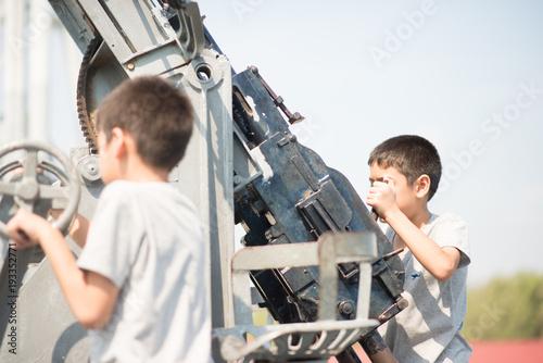 Sibling boy playing on the royal ship Poster