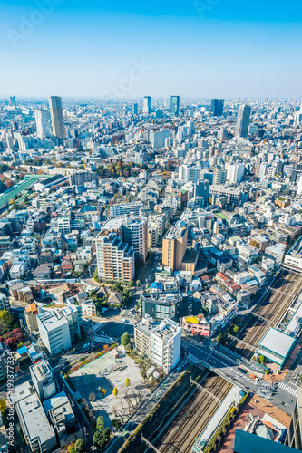 Aluminium Tokio Asia Business concept for real estate and corporate construction - panoramic modern city skyline aerial view of tokyo under blue sky in Tokyo, Japan