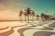 Quadro Sunny day with palms by Copacabana Beach mosaic boardwalk, Rio de Janeiro. Vintage colors with light leak