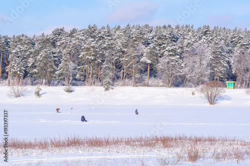 Keuken foto achterwand Blauwe hemel Protvino, Moscow region, Russia - February, 2, 2018: ice fishing on a frozen lake in Protvino, Moscow region, Russia