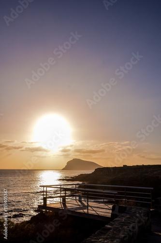 Foto op Aluminium Zee zonsondergang The Sun Setting in the Sea